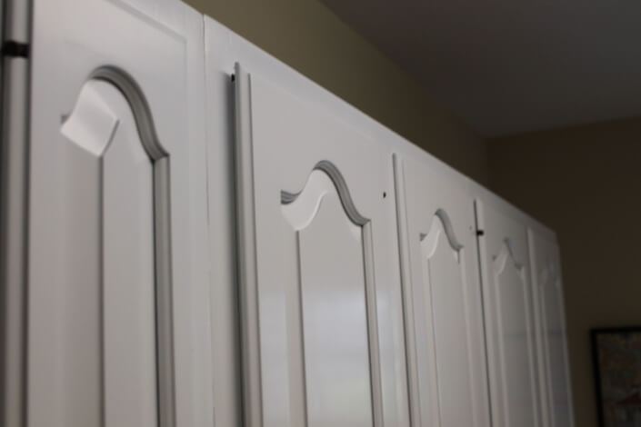 Baltimore Painting Company painting kitchen cabinets that look amazing