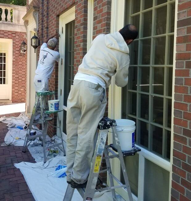 Man Prepping a home to paint in NW DC