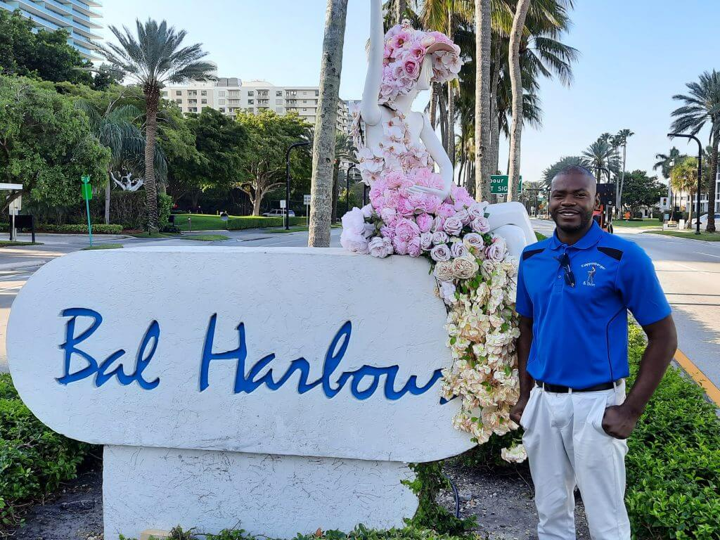 Miami painting contractor Rasheed Bowen standing in front of Bal Harbour sign