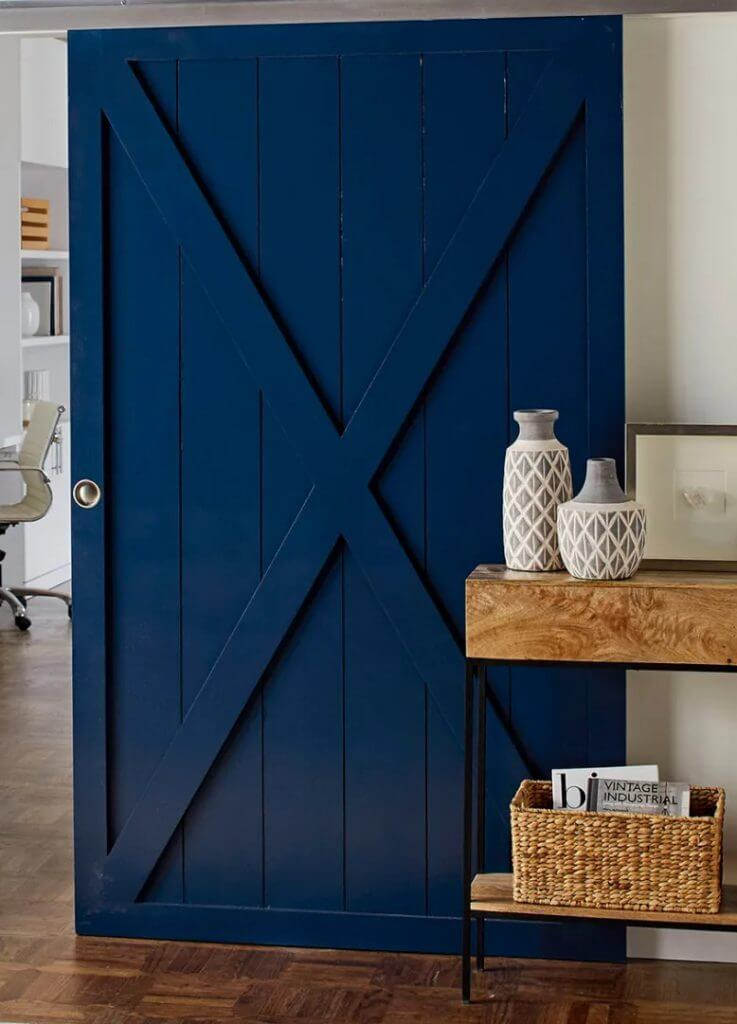 Door Installation like this blue door make functional and beautiful additions to this home