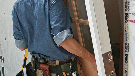 general handyman services includes a guy installing a new door
