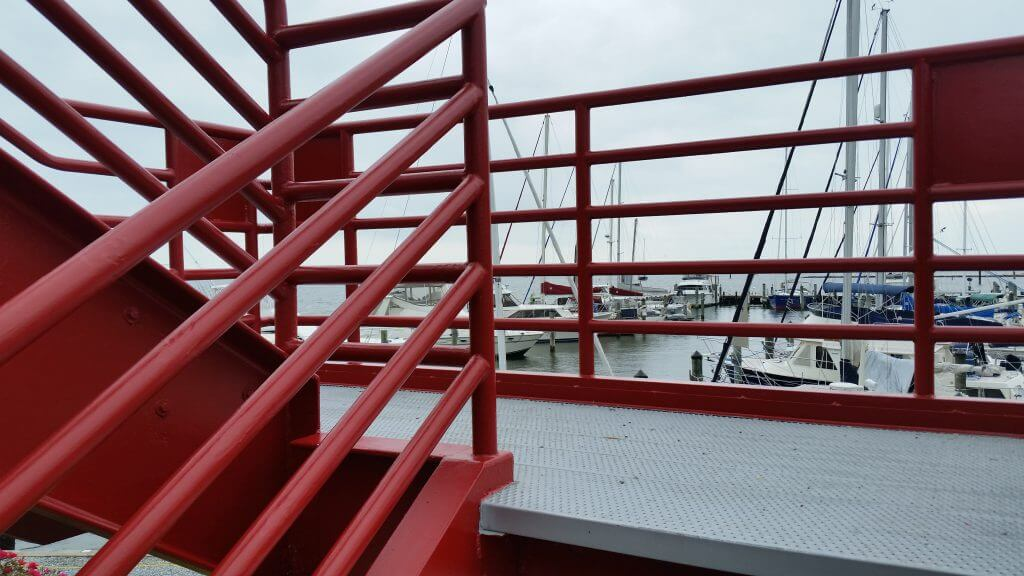 commercial painting of red handrail