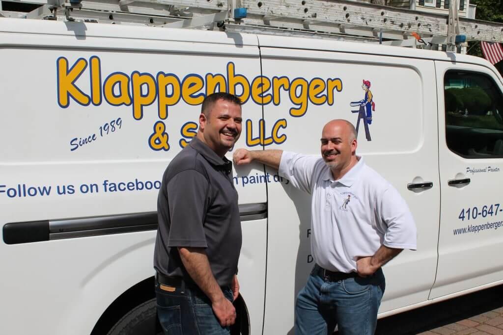 Klappenberger & Son Franchisee standing in front of van
