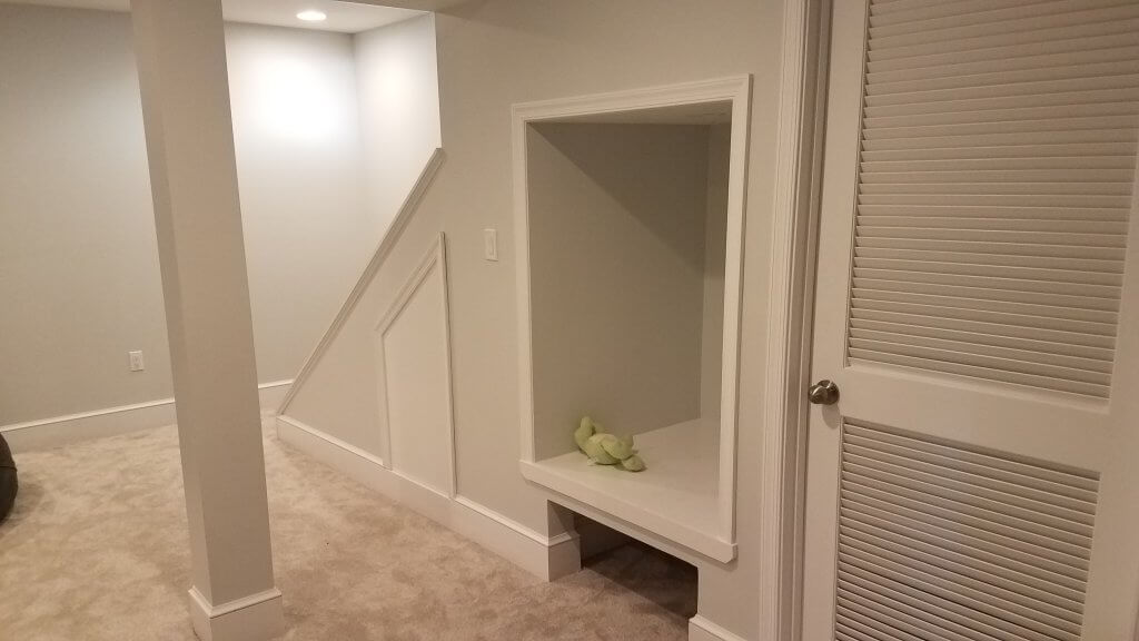 Basement remodeling allows knocks like this to be created under a staircase