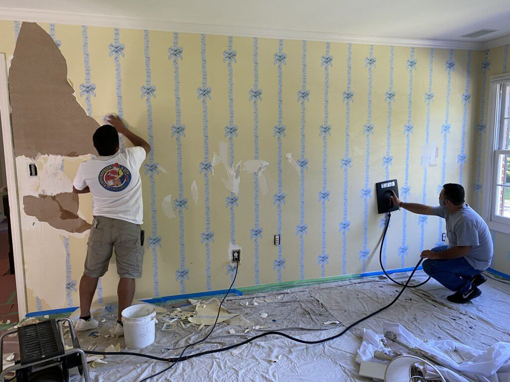 Klappenberger & Son Interior Painting Contractor removing wallpaper from bedroom