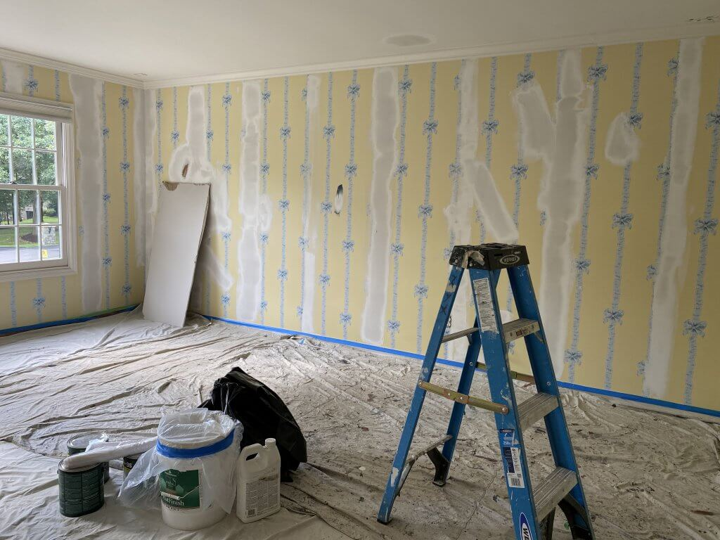 Klappenberger & Son spackling over wallpaper
