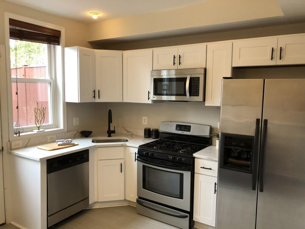 Painting Kitchen cabinets in Towson show the beautiful white cabinets