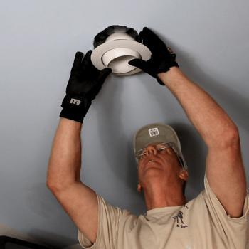 Handyman installing recess light