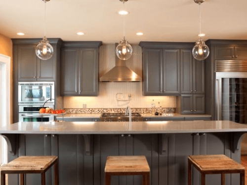 When Painting kitchen cabinets in Miami, many people choose white. But As the dark taupe cabinets show you don't have too.