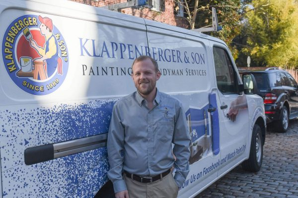Exterior Painting Contractor In NW DC standing by truck on Georgetown DC