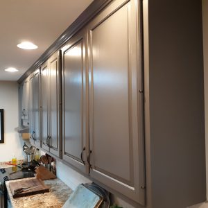 Painted kitchen cabinets from a stain to a dark taupe