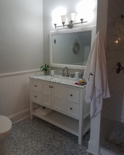 Bathroom renovations with new floor and painted vanity