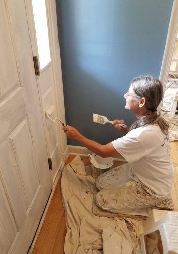 Lady Painter, painting door for Klappenberger & Son
