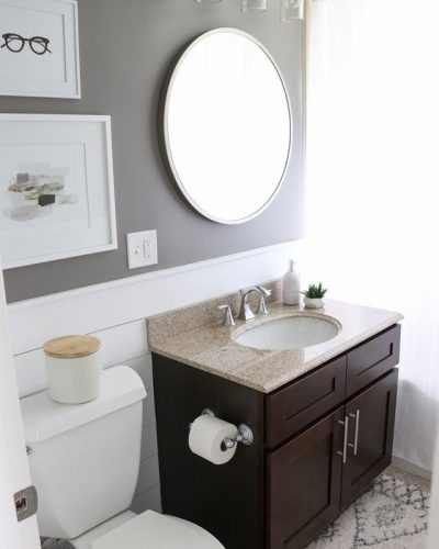 Bathroom remodel services include replacing vanity light and mirror