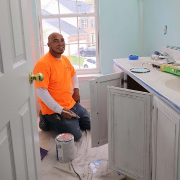 Klappenberger & Son Employee painting kitchen cabinets