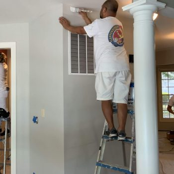 Klappenberger & Son crew painting the interior of a home