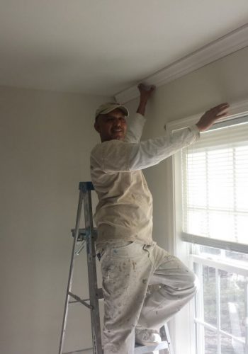 Painters in Anne Arundel County shown here installing crown molding